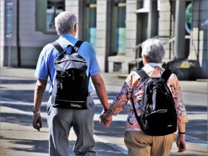 Senior couple walking after moving to one of the best places in California for seniors.